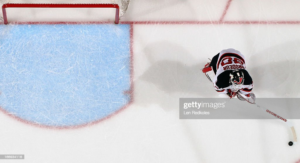 <a gi-track='captionPersonalityLinkClicked' href=/galleries/search?phrase=Martin+Brodeur&family=editorial&specificpeople=201594 ng-click='$event.stopPropagation()'>Martin Brodeur</a> #30 of the New Jersey Devils leaves his crease to play the puck against the Philadelphia Flyers on April 18, 2013 at the Wells Fargo Center in Philadelphia, Pennsylvania. The Devils went on to defeat the Flyers 3-0.