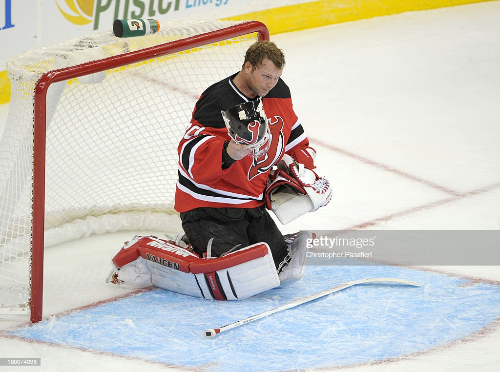 Martin Brodeur #30 of the New Jersey Devils looks on after deflecting a shot off his helmet during the game against the Washington Capitals on January 25, 2013 at the Prudential Center in Newark, New Jersey.