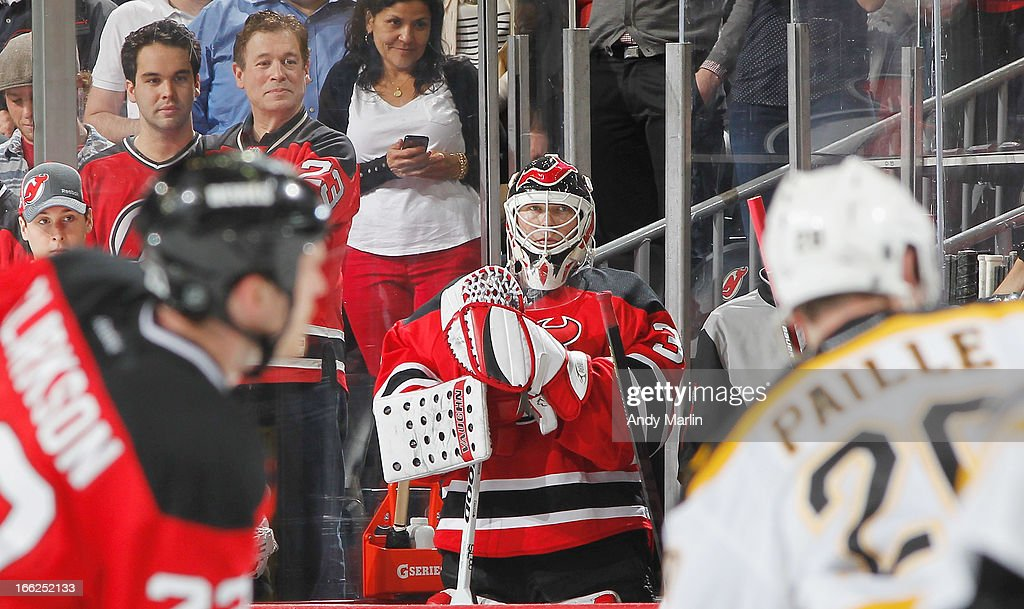 <a gi-track='captionPersonalityLinkClicked' href=/galleries/search?phrase=Martin+Brodeur&family=editorial&specificpeople=201594 ng-click='$event.stopPropagation()'>Martin Brodeur</a> #30 of the New Jersey Devils looks on from the bench after being pulled for an extra skater late in the third period against the Boston Bruins during the game at the Prudential Center on April 10, 2013 in Newark, New Jersey.