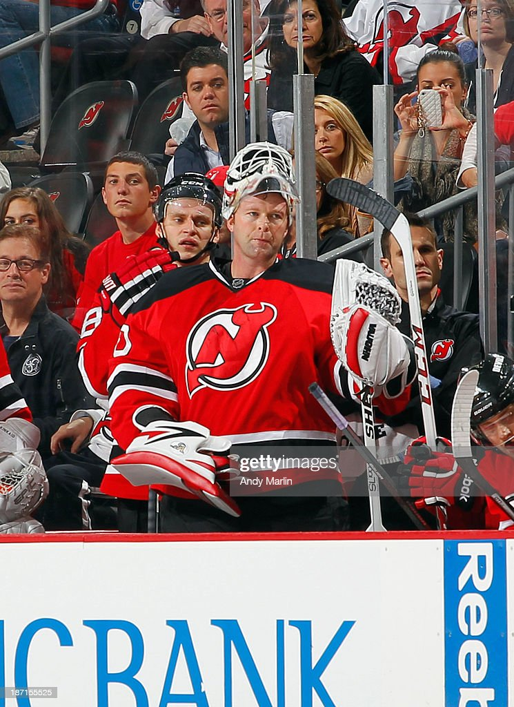 Martin Brodeur #30 of the New Jersey Devils looks on from the bench late in the third period after being pulled for an extra skater against the Philadelphia Flyers during the game at the Prudential Center on November 2, 2013 in Newark, New Jersey.