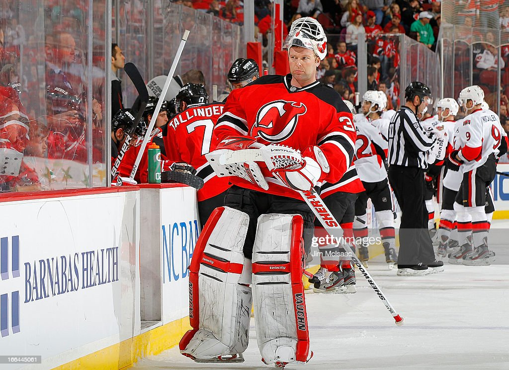 <a gi-track='captionPersonalityLinkClicked' href=/galleries/search?phrase=Martin+Brodeur&family=editorial&specificpeople=201594 ng-click='$event.stopPropagation()'>Martin Brodeur</a> #30 of the New Jersey Devils looks on in the third period during a timeout against the Ottawa Senators at the Prudential Center on April 12, 2013 in Newark, New Jersey.
