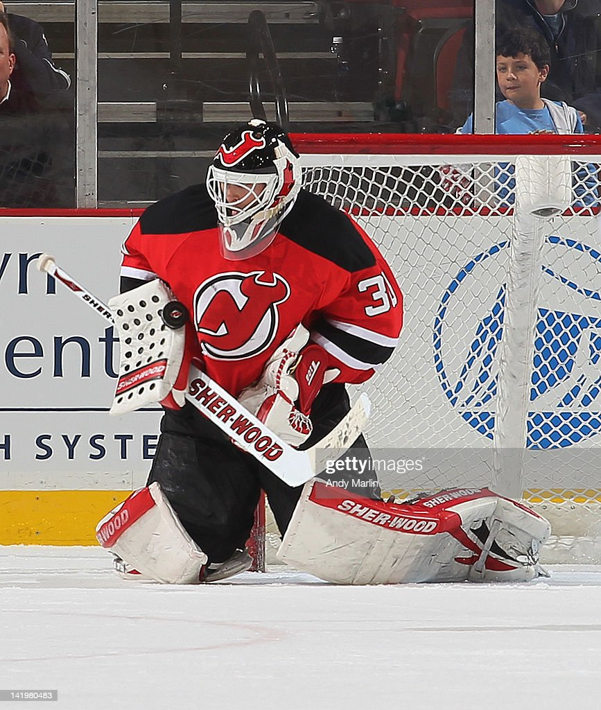 Martin Brodeur #30 of the New Jersey Devils makes a blocker save against the Chicago Blackhawks during the game at the Prudential Center on March 27, 2012 in Newark, New Jersey.