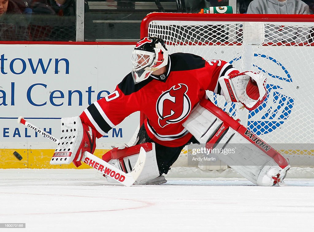 Martin Brodeur #30 of the New Jersey Devils makes a blocker save against the Washington Capitals during the game at the Prudential Center on January 25, 2013 in Newark, New Jersey.