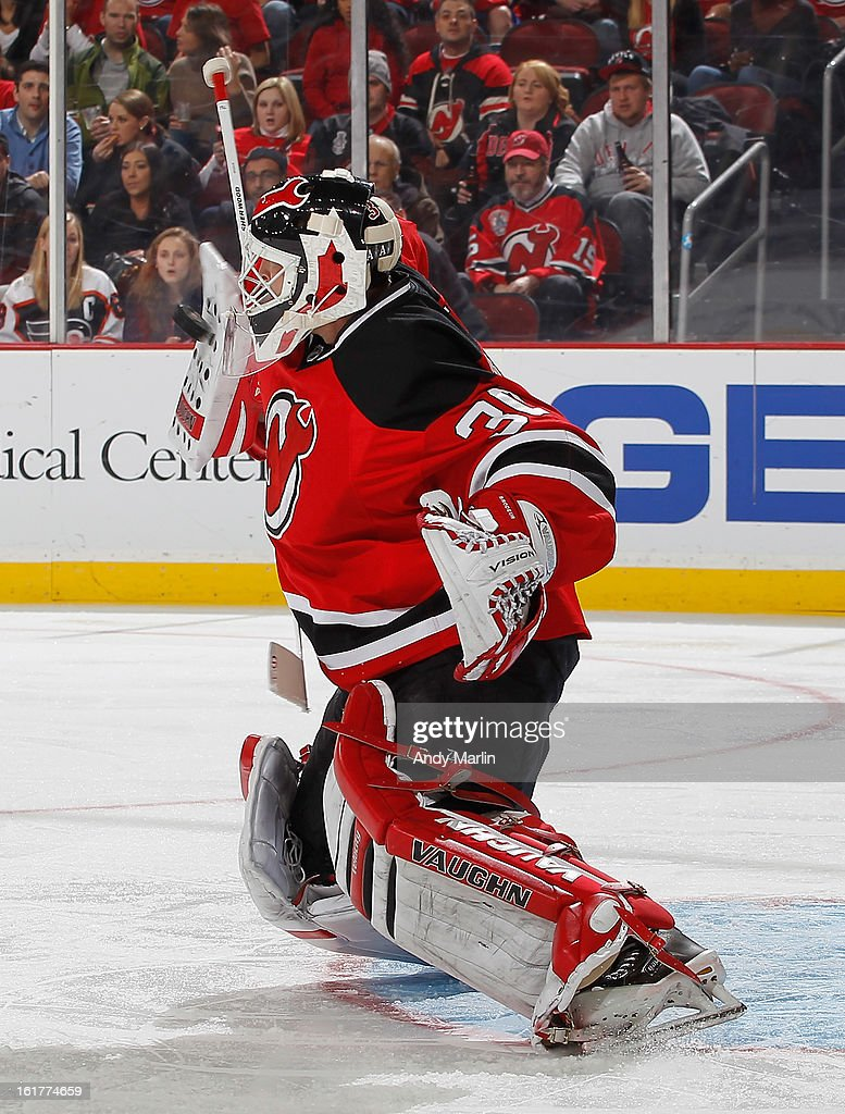 <a gi-track='captionPersonalityLinkClicked' href=/galleries/search?phrase=Martin+Brodeur&family=editorial&specificpeople=201594 ng-click='$event.stopPropagation()'>Martin Brodeur</a> #30 of the New Jersey Devils makes a blocker save against the Philadelphia Flyers during the game at the Prudential Center on February 15, 2013 in Newark, New Jersey.