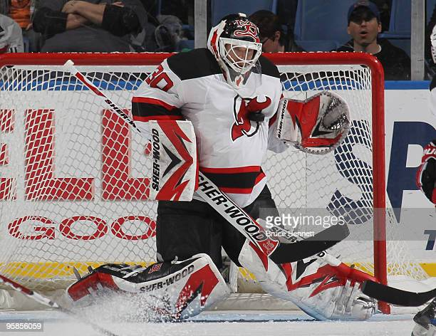 Martin Brodeur of the New Jersey Devils makes a chest save in the first period against the New York Islanders at the Nassau Coliseum on January 18...