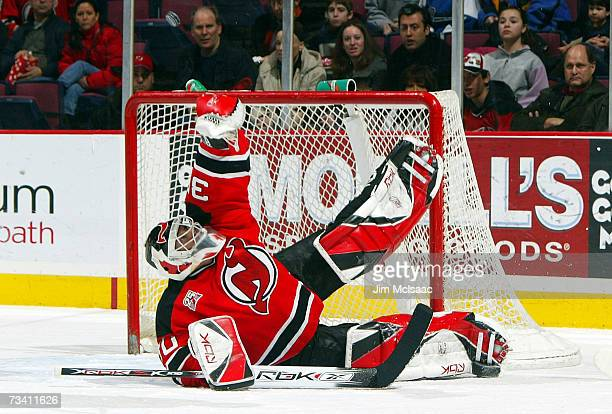Martin Brodeur of the New Jersey Devils makes a glove save against the Washington Capitals during their game on February 24 2007 at Continental...