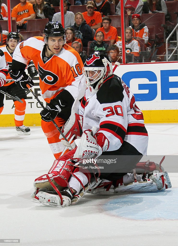<a gi-track='captionPersonalityLinkClicked' href=/galleries/search?phrase=Martin+Brodeur&family=editorial&specificpeople=201594 ng-click='$event.stopPropagation()'>Martin Brodeur</a> #30 of the New Jersey Devils makes a glove save as <a gi-track='captionPersonalityLinkClicked' href=/galleries/search?phrase=Brayden+Schenn&family=editorial&specificpeople=4782304 ng-click='$event.stopPropagation()'>Brayden Schenn</a> #10 of the Philadelphia Flyers waits for a rebound chance on April 18, 2013 at the Wells Fargo Center in Philadelphia, Pennsylvania. The Devils went on to defeat the Flyers 3-0.
