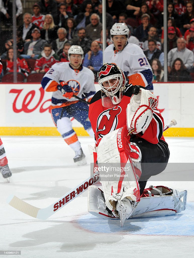 Martin Brodeur #30 of the New Jersey Devils makes a glove save during the third period against the New York Islanders on March 8, 2012 at the Prudential Center in Newark, New Jersey.