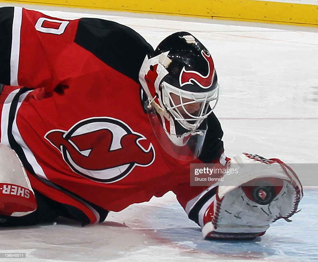 <a gi-track='captionPersonalityLinkClicked' href=/galleries/search?phrase=Martin+Brodeur&family=editorial&specificpeople=201594 ng-click='$event.stopPropagation()'>Martin Brodeur</a> #30 of the New Jersey Devils makes a glove save in the third period against the New York Rangers at the Prudential Center on December 20, 2011 in Newark, New Jersey.
