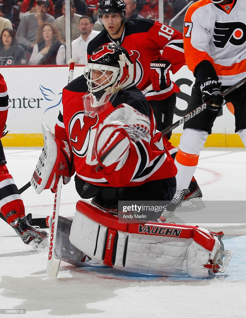 Martin Brodeur #30 of the New Jersey Devils makes a glove save on his way to his NHL record 120th shutout against the Philadelphia Flyers during the Devils home opener at the Prudential Center on January 22, 2013 in Newark, New Jersey.