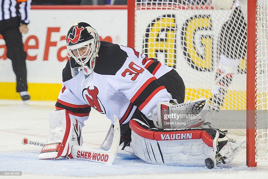 <a gi-track='captionPersonalityLinkClicked' href=/galleries/search?phrase=Martin+Brodeur&family=editorial&specificpeople=201594 ng-click='$event.stopPropagation()'>Martin Brodeur</a> #30 of the New Jersey Devils makes a pad save against the Calgary Flames during an NHL game at Scotiabank Saddledome on October 11, 2013 in Calgary, Alberta, Canada. The Calgary Flames defeated the New Jersey Devils 3-2.