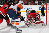 Martin Brodeur of the New Jersey Devils makes a save against John Tavares of the New York Islanders at the Prudential Center on April 10 2010 in...