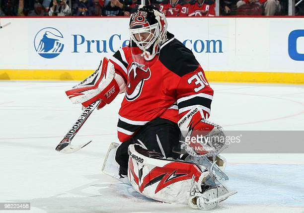 Martin Brodeur of the New Jersey Devils makes a save against the Chicago Blackhawks at the Prudential Center on April 2 2010 in Newark New Jersey The...