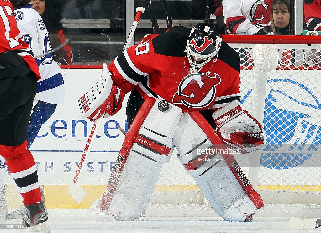 Martin Brodeur #30 of the New Jersey Devils makes a save against the Tampa Bay Lightning at the Prudential Center on February 7, 2013 in Newark, New Jersey.