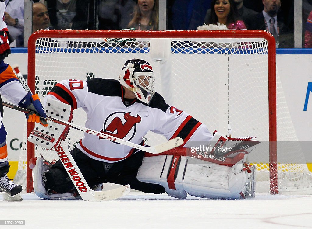 Martin Brodeur #30 of the New Jersey Devils makes a save against the New York Islanders during the Islanders home opener at the Nassau Coliseum on January 19, 2013 in Uniondale, New York.