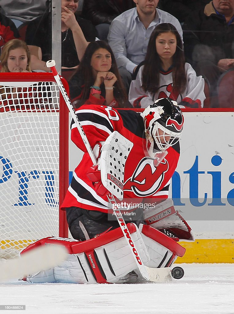 Martin Brodeur #30 of the New Jersey Devils makes a save against the New York Islanders during the game at the Prudential Center on January 31, 2013 in Newark, New Jersey.