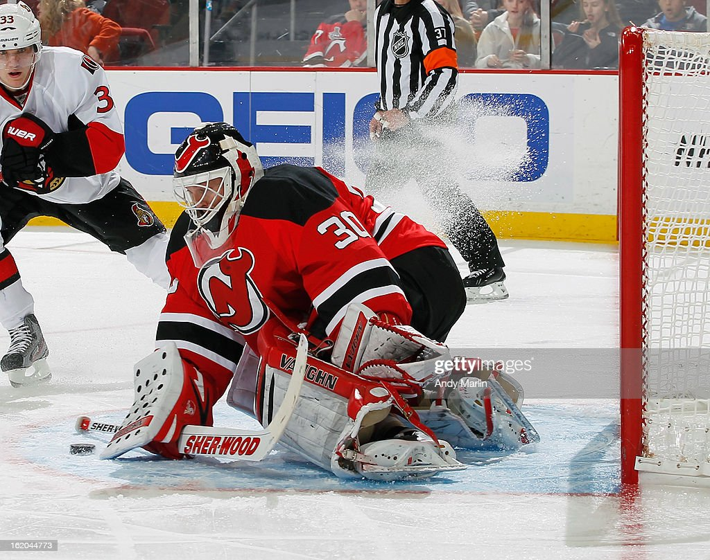 <a gi-track='captionPersonalityLinkClicked' href=/galleries/search?phrase=Martin+Brodeur&family=editorial&specificpeople=201594 ng-click='$event.stopPropagation()'>Martin Brodeur</a> #30 of the New Jersey Devils makes a save against the Ottawa Senators during the game at the Prudential Center on February 18, 2013 in Newark, New Jersey.