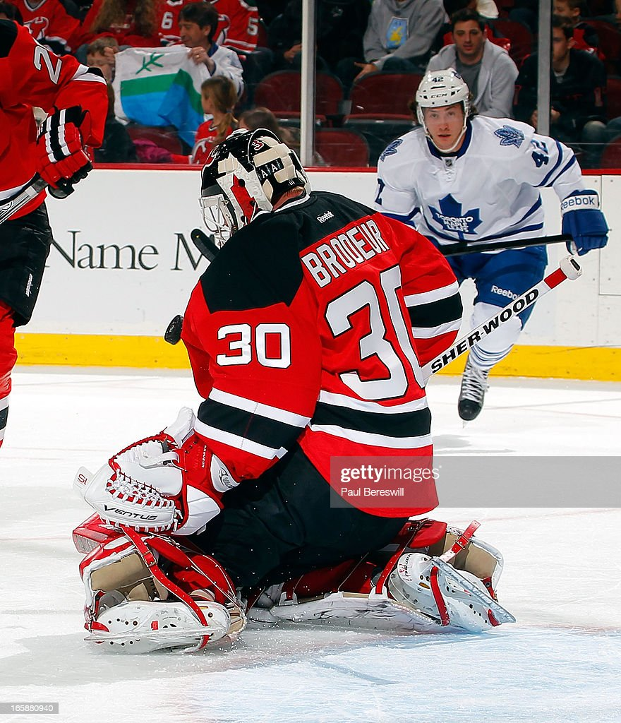 Martin Brodeur #30 of the New Jersey Devils makes a save in the first period of an NHL hockey game against the Toronto Maple Leafs at Prudential Center on April 6, 2013 in Newark, New Jersey.