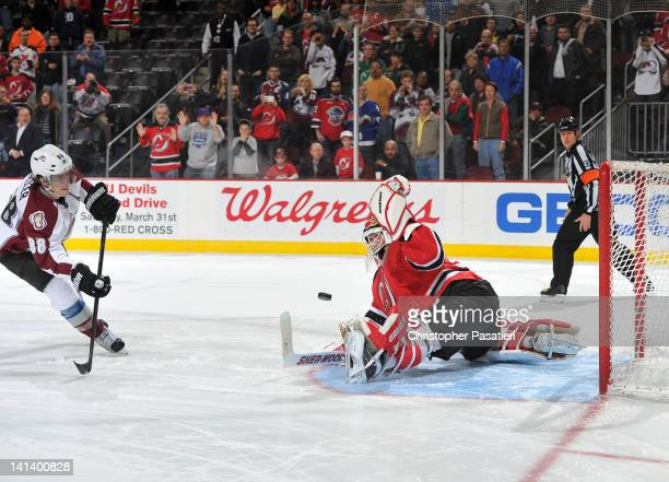 Martin Brodeur of the New Jersey Devils makes the game winning save against Peter Mueller of the Colorado Avalanche during the shoot out on March 15...