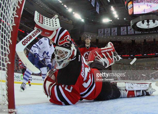 Martin Brodeur of the New Jersey Devils makes the third period save against the Toronto Maple Leafs at the Prudential Center on March 23 2012 in...