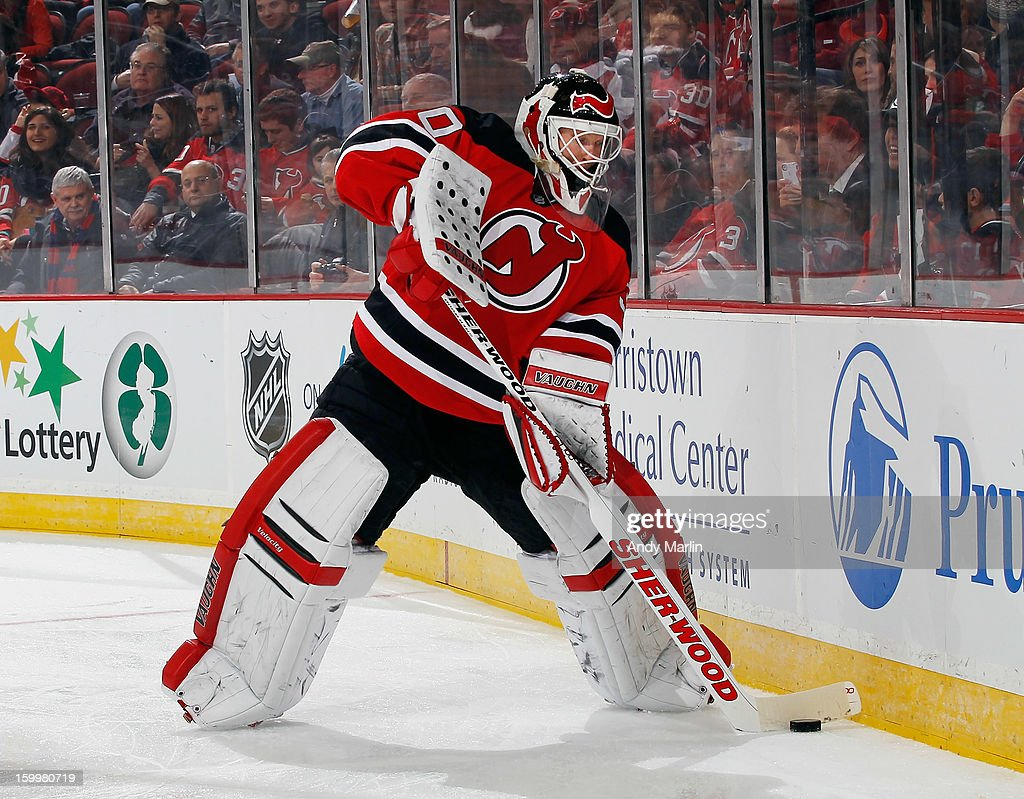 Martin Brodeur #30 of the New Jersey Devils plays the puck against the Philadelphia Flyers during the Devils home opener at the Prudential Center on January 22, 2013 in Newark, New Jersey.