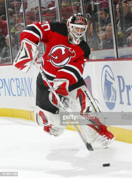 Martin Brodeur of the New Jersey Devils plays the puck against the Carolina Hurricanes during their game at the Prudential Center on October 17 2009...