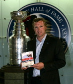 Martin Brodeur of the New Jersey Devils poses in front of the Stanley Cup at the launching of his book 'Brodeur Beyond the Crease' in the Great Hall...
