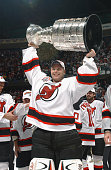 Martin Brodeur of the New Jersey Devils raises the Stanley Cup after defeating the Mighty Ducks of Anaheim in game seven of the 2003 Stanley Cup...