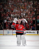 Martin Brodeur of the New Jersey Devils salutes the fan while leaving the ice following a 32 victory over the Boston Bruins at the Prudential Center...