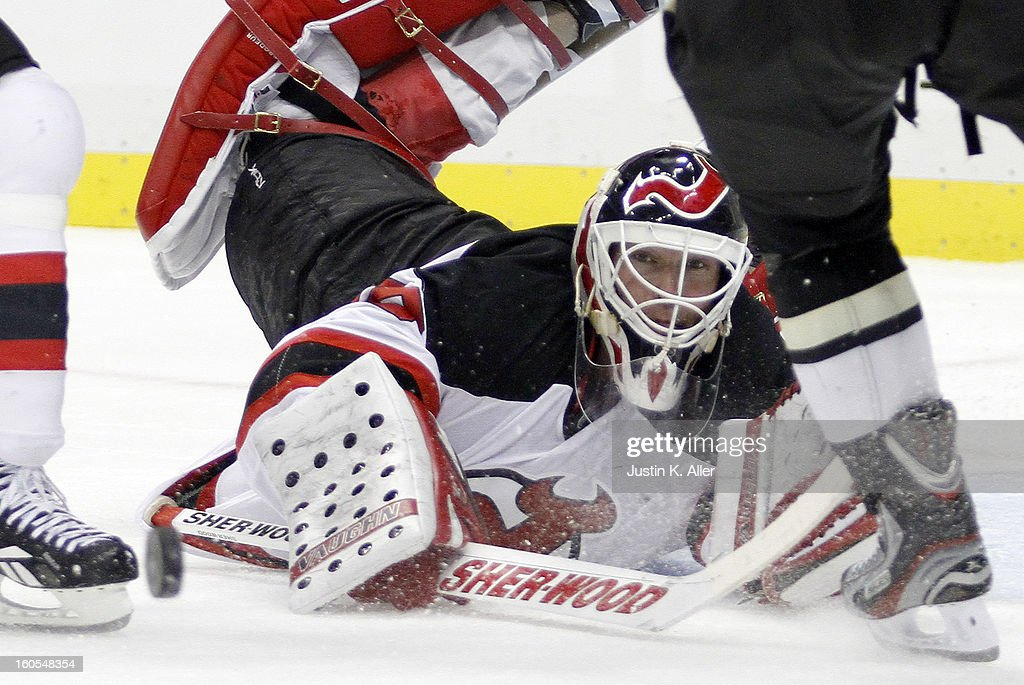 <a gi-track='captionPersonalityLinkClicked' href=/galleries/search?phrase=Martin+Brodeur&family=editorial&specificpeople=201594 ng-click='$event.stopPropagation()'>Martin Brodeur</a> #30 of the New Jersey Devils scrambles to find the puck against the Pittsburgh Penguins during the game at Consol Energy Center on February 2, 2013 in Pittsburgh, Pennsylvania. The Penguins defeated the Devils 5-1.