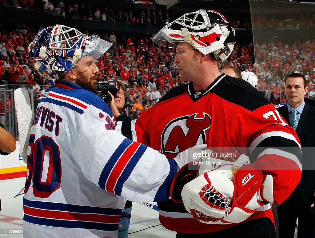 Martin Brodeur of the New Jersey Devils shakes hands with Henrik Lundqvist of the New York Rangers after the Devils defeating the Rangers by a score...