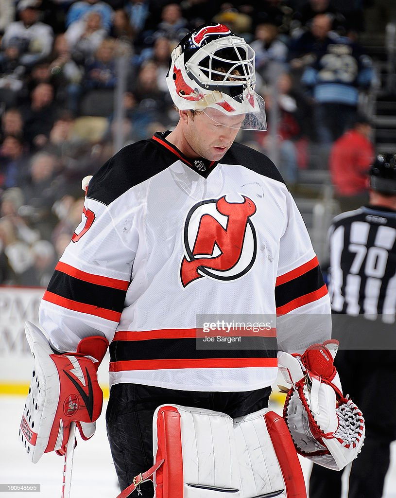 Martin Brodeur #30 of the New Jersey Devils skates to the bench during a timeout against the Pittsburgh Penguins on February 2, 2013 at Consol Energy Center in Pittsburgh, Pennsylvania. Pittsburgh won the game 5-1.