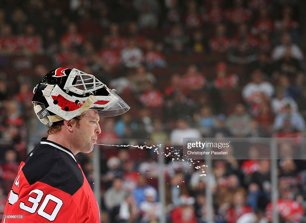 Martin Brodeur #30 of the New Jersey Devils spits water during the second period against the New York Islanders on March 8, 2012 at the Prudential Center in Newark, New Jersey.