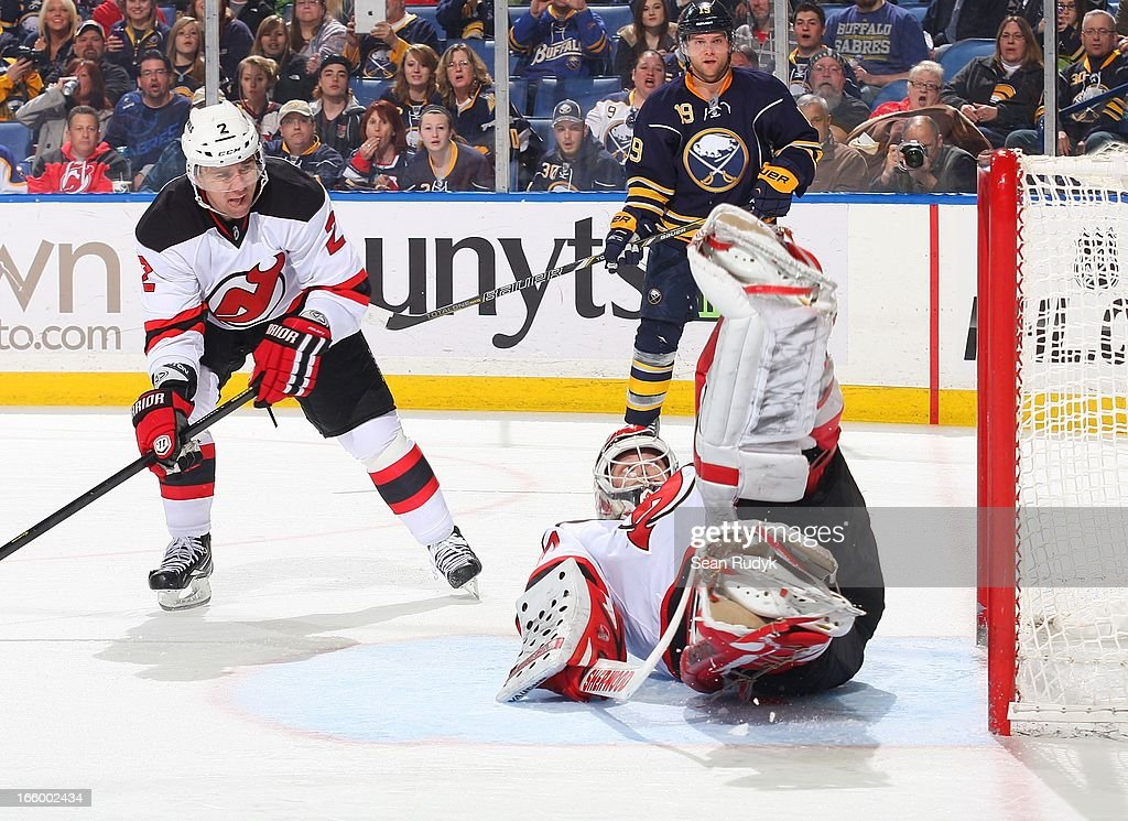 Martin Brodeur #30 of the New Jersey Devils sprawls to make a save in front of teammate Marek Zidlicky #2 and Cody Hodgson #19 of the Buffalo Sabres on April 7, 2013 at the First Niagara Center in Buffalo, New York.