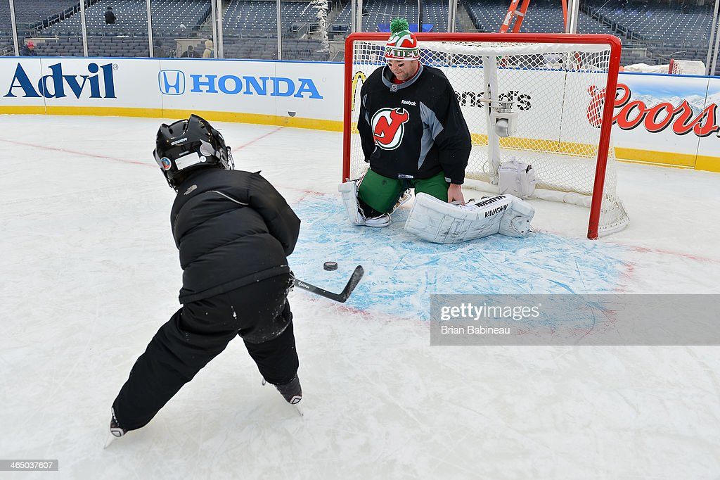 <a gi-track='captionPersonalityLinkClicked' href=/galleries/search?phrase=Martin+Brodeur&family=editorial&specificpeople=201594 ng-click='$event.stopPropagation()'>Martin Brodeur</a> #30 of the New Jersey Devils stands in goal during the 2014 NHL Stadium Series family skate at Yankee Stadium on January 25, 2014 in New York City.