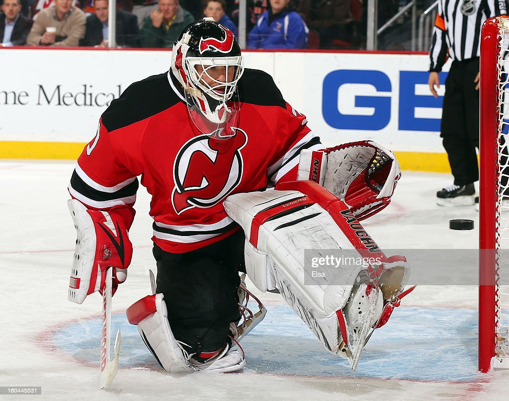 <a gi-track='captionPersonalityLinkClicked' href=/galleries/search?phrase=Martin+Brodeur&family=editorial&specificpeople=201594 ng-click='$event.stopPropagation()'>Martin Brodeur</a> #30 of the New Jersey Devils stops a shot in the third period against the New York Islanders at the Prudential Center on January 31, 2013 in Newark, New Jersey.The New York Islanders defeated the New Jersey Devils 5-4 in overtime.