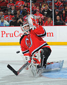 Martin Brodeur of the New Jersey Devils stops a shot on goal during the shoot out against the Detroit Red Wings on December 5 2009 at the Prudential...
