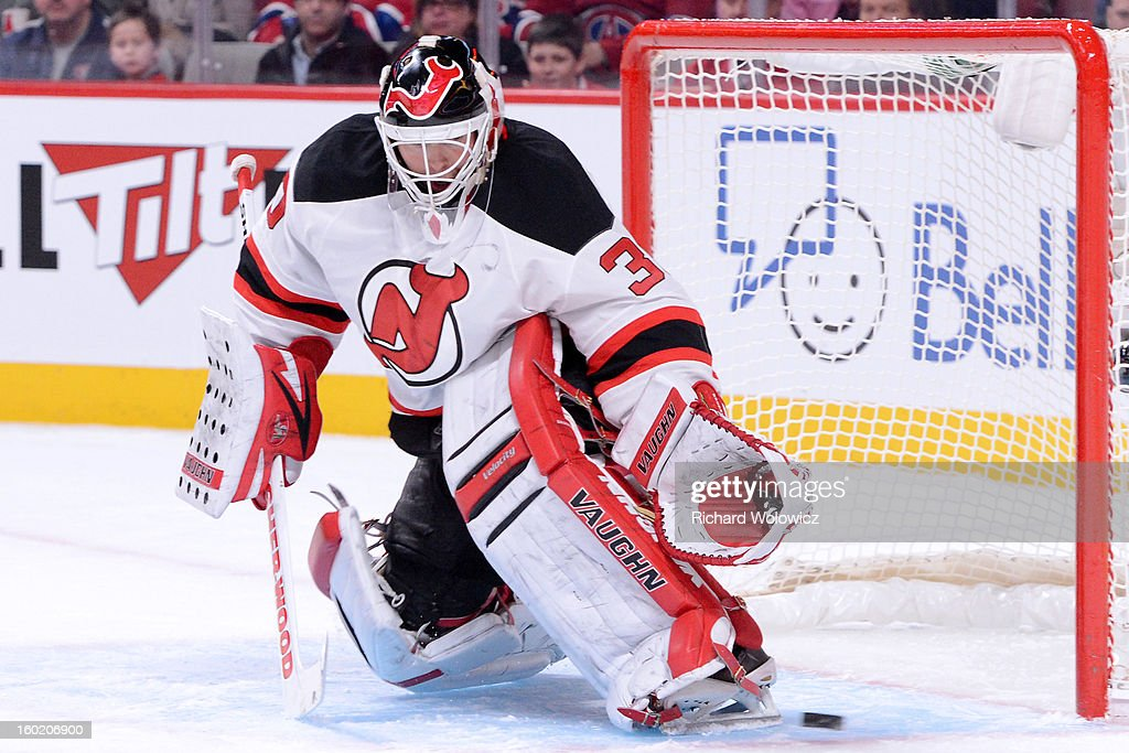 Martin Brodeur #30 of the New Jersey Devils stops the puck during the NHL game against the Montreal Canadiens at the Bell Centre on January 27, 2013 in Montreal, Quebec, Canada.