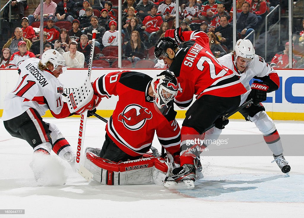 <a gi-track='captionPersonalityLinkClicked' href=/galleries/search?phrase=Martin+Brodeur&family=editorial&specificpeople=201594 ng-click='$event.stopPropagation()'>Martin Brodeur</a> #30 of the New Jersey Devils turns and makes a save as <a gi-track='captionPersonalityLinkClicked' href=/galleries/search?phrase=Bryce+Salvador&family=editorial&specificpeople=208746 ng-click='$event.stopPropagation()'>Bryce Salvador</a> #24 battles for the rebound in the crease against <a gi-track='captionPersonalityLinkClicked' href=/galleries/search?phrase=Daniel+Alfredsson&family=editorial&specificpeople=201853 ng-click='$event.stopPropagation()'>Daniel Alfredsson</a> #11 and <a gi-track='captionPersonalityLinkClicked' href=/galleries/search?phrase=Kyle+Turris&family=editorial&specificpeople=4251834 ng-click='$event.stopPropagation()'>Kyle Turris</a> #7 of the Ottawa Senators during the game at the Prudential Center on February 18, 2013 in Newark, New Jersey.