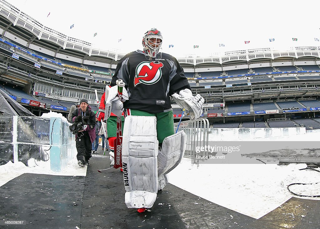 Martin Brodeur of the New Jersey Devils walks out for practice the day before the outdoor game against the New York Rangers at Yankee Stadium on...