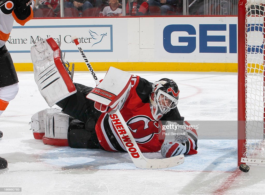 <a gi-track='captionPersonalityLinkClicked' href=/galleries/search?phrase=Martin+Brodeur&family=editorial&specificpeople=201594 ng-click='$event.stopPropagation()'>Martin Brodeur</a> #30 of the New Jersey Devils watches a shot by the Philadelphia Flyers slide harmlessly past the goal during the third period of an NHL hockey game at Prudential Center on November 2, 2013 in Newark, New Jersey.