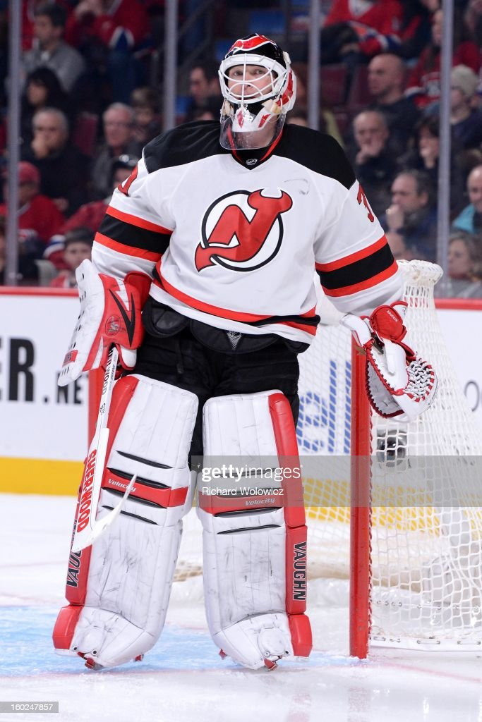 Martin Brodeur #30 of the New Jersey Devils watches play during the NHL game against the Montreal Canadiens at the Bell Centre on January 27, 2013 in Montreal, Quebec, Canada. The Canadiens defeated the Devils 4-3 in overtime.