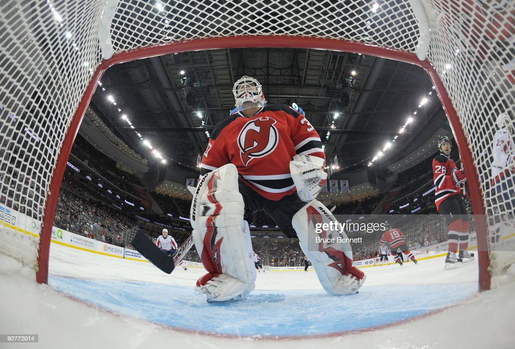 Martin Brodeur of the New Jersey Devils watches the play behind the net in his game against the Washington Capitals at the Prudential Center on...