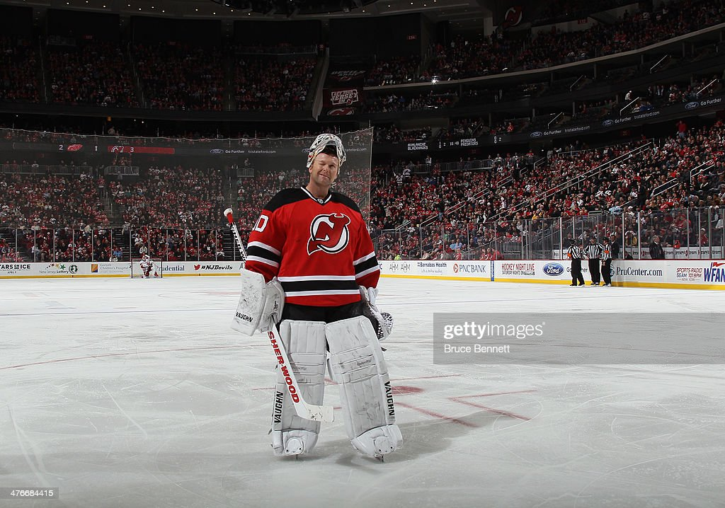 Martin Brodeur of the New Jersey Devils winks at the crowd after the Devils took a 32 lead in the third period against the Detroit Red Wings at the...