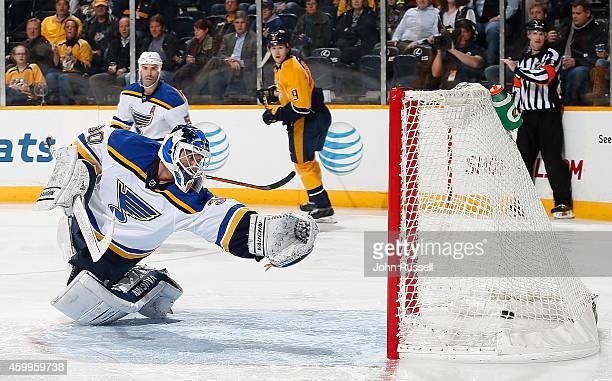 Martin Brodeur of the St Louis Blues is beaten by Mike Ribeiro of the Nashville Predators at Bridgestone Arena on December 4 2014 in Nashville...