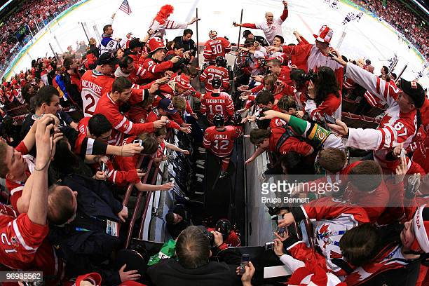 Martin Brodeur Scott Niedermayer Joe Thornton and Jarome Iginla of Canada taake the ice as fans cheer prior to playing the ice hockey men's...