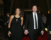 Martin Broduer and his wife Genevieve Nault walk the red carpet prior to the induction ceremony at the Hockey Hall of Fame on November 17 2014 in...