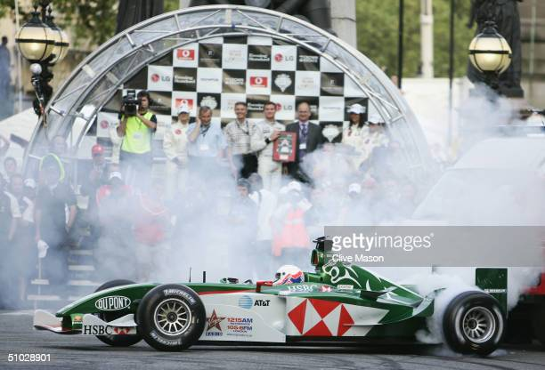 Martin Brundle of Great Britain drives the Jaguar Formula One car through the streets of London during the Formula One Regent Street Parade in Regent...
