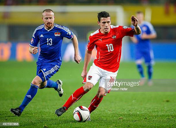 Martin Buechel of Liechtenstein competes for the ball with Zlatko Junuzovic of Austria during the UEFA EURO 2016 Qualifier between Austria and...