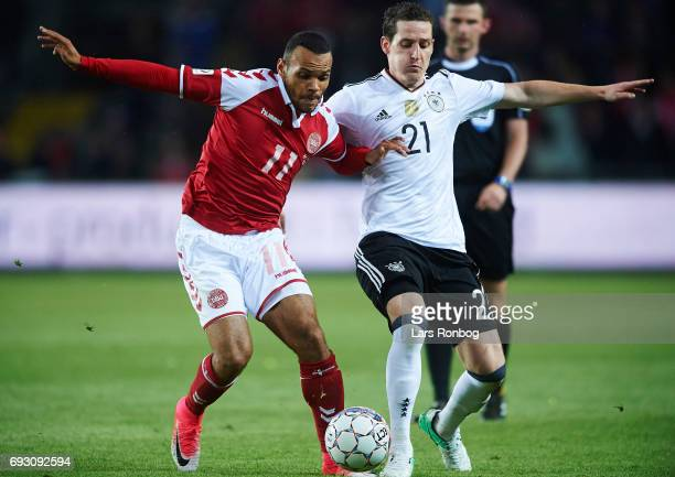 Martin C Braithwaite of Denmark and Sebastian Rudy of Germany compete for the ball during the international friendly match between Denmark and...